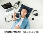 top view of asian man lying on... | Shutterstock . vector #583211848
