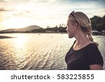 young woman at tropical beach... | Shutterstock . vector #583225855