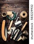 gardening tools on dark wooden... | Shutterstock . vector #583229932