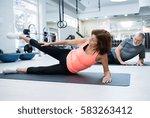 senior couple in gym working... | Shutterstock . vector #583263412