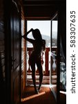 silhouette girl at the door on... | Shutterstock . vector #583307635