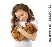 Stock photo cute child little girl with red puppy isolated on white background kid pet friendship 583397452