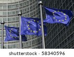 European flags in front of the European Commission headquarters in Brussels, Belgium - stock photo