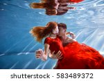Underwater In The Pool With Th...