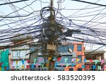 the chaos of cables and wires... | Shutterstock . vector #583520395