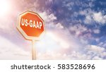 Small photo of US-GAAP accounting system on red traffic road stop sign in front of blue sky with clouds and friendly sun beams, digital composing with light leaks and flares
