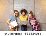 multi ethnic coworkers dressed... | Shutterstock . vector #583534066