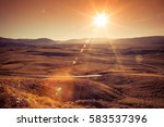 scenic mountain road at sunset...   Shutterstock . vector #583537396
