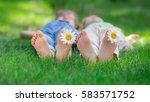 happy children playing outdoors....   Shutterstock . vector #583571752