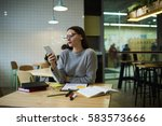 Small photo of Skilled well-dressed female restaurant owner messaging with marketing expert discussing details of collaboration planning to make advertising campaign using free wireless internet and smartphone