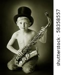 young boy with hat and sax in...