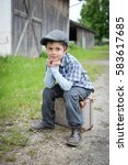 young boy sitting on vintage... | Shutterstock . vector #583617685