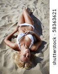 Sexy Blond Girl Lying On A Beach