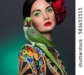 Beautiful Girl With A Parrot...