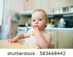 cute little girl in the kitchen ... | Shutterstock . vector #583668442