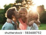 parents kissing their smiling... | Shutterstock . vector #583688752
