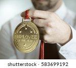 employee holding golden medal... | Shutterstock . vector #583699192