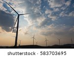 wind turbine farm with rays of... | Shutterstock . vector #583703695