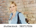 portrait of young blonde woman... | Shutterstock . vector #583717036