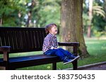 upset little baby boy crying... | Shutterstock . vector #583750435