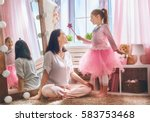 Small photo of Happy loving family. Mother and her daughter in kids room. Funny mom and lovely child having fun indoors. Cute little girl is playing Princess fairy.
