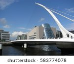 The main span of the Samuel Beckett Bridge in Dublin is supported by cable stays from a doubly back-stayed single forward arc tubular tapered spar