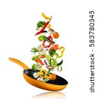 fresh vegetables flying into a... | Shutterstock . vector #583780345