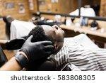 barber or hairdresser massaging ...   Shutterstock . vector #583808305