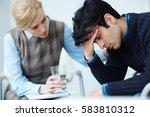 tense man touching his head... | Shutterstock . vector #583810312