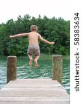 boy jumping off dock - stock photo
