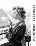 beautiful girl smokes a...   Shutterstock . vector #583848286