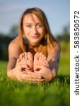 a focus on a feet of a girl... | Shutterstock . vector #583850572