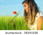 Young Woman In Green Field...