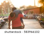 father and son walking together  | Shutterstock . vector #583966102