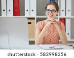 businesswoman sitting at table... | Shutterstock . vector #583998256