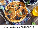 pancakes on plate with... | Shutterstock . vector #584008012