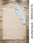 vintage sheet of paper feather... | Shutterstock . vector #584015176