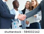 business people shaking hands ... | Shutterstock . vector #584032162