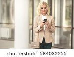 beautiful business woman in... | Shutterstock . vector #584032255