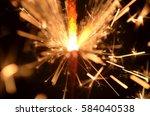 burning sparkler isolated on... | Shutterstock . vector #584040538