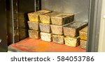 a few golden ingots | Shutterstock . vector #584053786