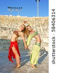 Beautiful belly dancers  in the ancient Kourion amphitheatre in Cyprus. - stock photo