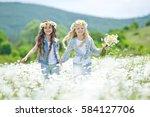 little girl in a field with... | Shutterstock . vector #584127706