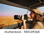 woman taking photo aboard... | Shutterstock . vector #584139268