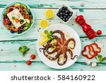 grilled octopus served on white ... | Shutterstock . vector #584160922