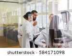 team of doctors and nurses in... | Shutterstock . vector #584171098