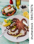 grilled octopus plate with... | Shutterstock . vector #584178076