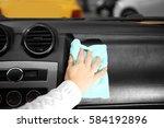 closeup of woman cleaning a car ... | Shutterstock . vector #584192896