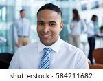 portrait of smiling businessman ... | Shutterstock . vector #584211682