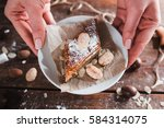 hands taking saucer with sweet... | Shutterstock . vector #584314075